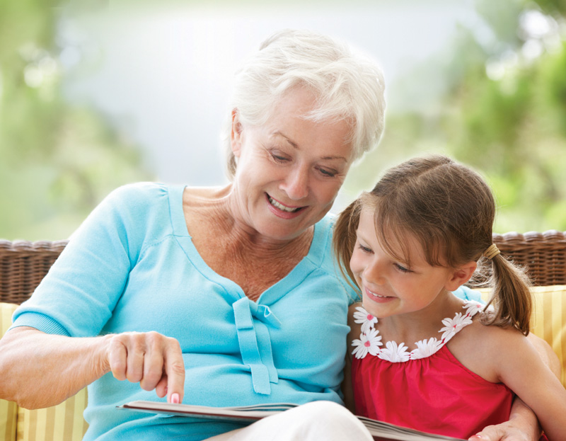 Grandmother and granddaughter reading together