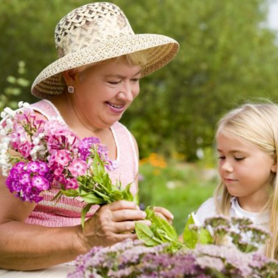 Grandma & child picking flowers