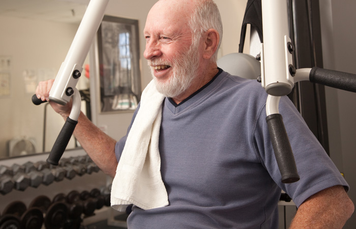 Senior using exercise equipment